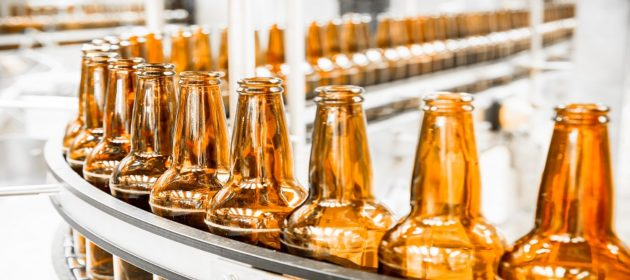 Amber bottles on assembly line