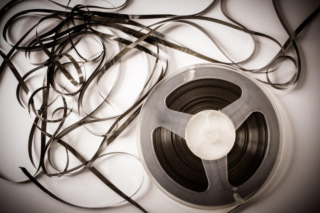 magnetic tape reel made using magnetite